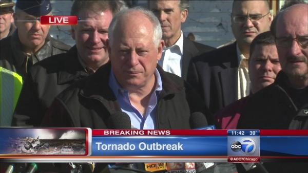 Quinn tours tornado damage