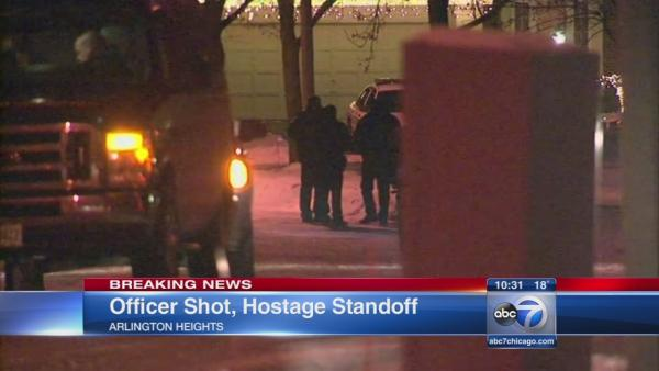 Officer shot, hostage standoff in Arlington Heights