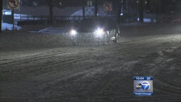 Roads, air travel messy as snow moves through