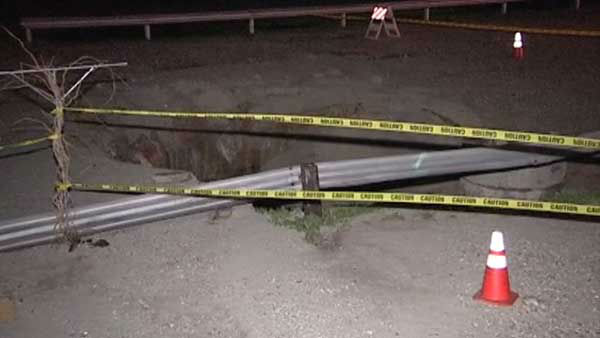 Heavy rain may be to blame for storm damage in Calumet City. A giant hole opened up in the south suburb after what appears to be a pipe explosion. <span class=meta>(WLS Photo)</span>