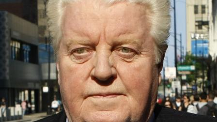In this May 24, 2010 file photo, former Chicago police Lt. Jon Burge  leaves the Federal Courthouse after the first day of jury selection in his obstruction of justice and perjury trial.  (AP Photo/Charles Rex Arbogast, File)