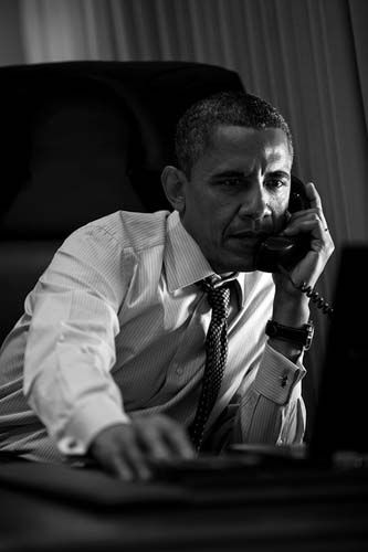 President Barack Obama talks on the phone with Prime Minister Mario Monti of Italy aboard Air Force One, June 6, 2012. &#40;Official White House Photo by Pete Souza&#41; <span class=meta>(Photo&#47;The White House)</span>