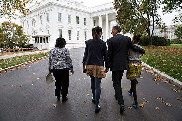 President Barack Obama walks with Kaye Wilson, left, and daughters Malia, center, and Sasha as they return to the White House from St. John&#39;s Episcopal Church in Washington, D.C., Sunday, Oct. 28, 2012. &#40;Official White House Photo by Pete Souza&#41; <span class=meta>(Photo&#47;The White House)</span>