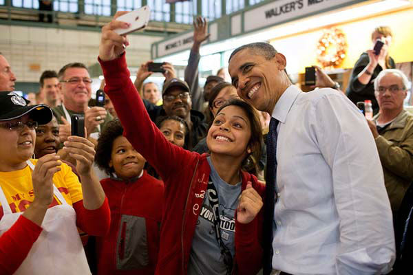 President Barack Obama has his picture taken with a patron at the West Side Market in Cleveland, Ohio, Oct. 5, 2012. &#40;Official White House Photo by Pete Souza&#41; <span class=meta>(Photo&#47;The White House)</span>