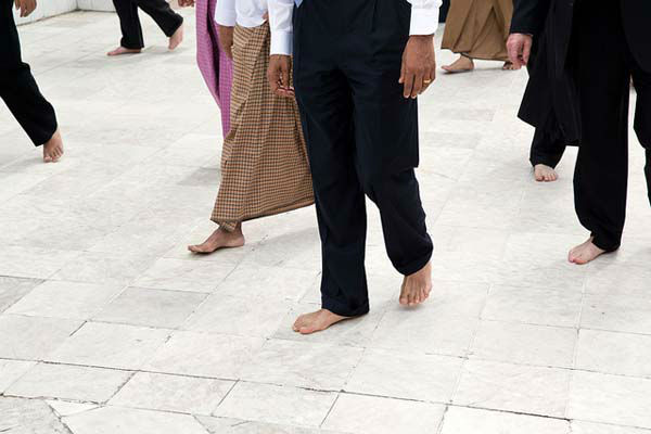"<div class=""meta ""><span class=""caption-text "">President Barack Obama, guides, and Secret Service agents walk barefoot during a tour of the Shwedagon Pagoda in Rangoon, Burma, Nov. 19, 2012. (Official White House Photo by Pete Souza) (Photo/The White House)</span></div>"