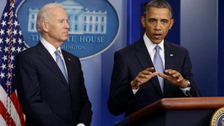 President Barack Obama and Vice President Joe Biden make a statement regarding the passage of the fiscal cliff bill in the Brady Press Briefing Room at the White House in Washington.