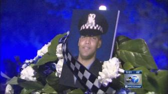 Slain officers family settles with pawn shop