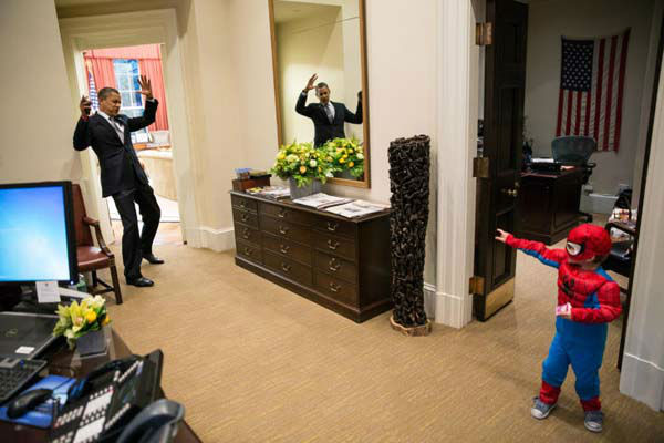 President Barack Obama reacts as a boy dressed as spiderman pretends he is throwing a web. <span class=meta>(Photo&#47;The White House)</span>