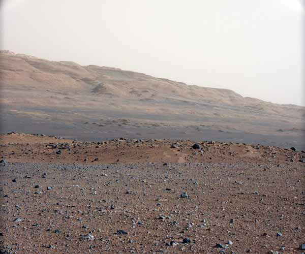 In this image released by NASA on Monday, Aug. 27, 2012, an image taken by the Mast Camera &#40;MastCam&#41; highlights the geology of Mount Sharp, a mountain inside Gale Crater, where the rover landed. Prior to the rover&#39;s landing on Mars, observations from orbiting satellites indicated that the lower reaches of Mount Sharp, below the line of white dots, are composed of relatively flat-lying strata that bear hydrated minerals. Those orbiter observations did not reveal hydrated minerals in the higher, overlying strata. The MastCam data now reveal a strong discontinuity in the strata above and below the line of white dots, agreeing with the data from orbit. Strata overlying the line of white dots are highly inclined &#40;dipping from left to right&#41; relative to lower, underlying strata. The inclination of these strata above the line of white dots is not obvious from orbit. This provides independent evidence that the absence of hydrated minerals on the upper reaches of Mount Sharp may coincide with a very different formation environment than lower on the slopes. The train of white dots may represent an &#34;unconformity,&#34; or an area where the process of sedimentation stopped. &#40;AP Photo&#47;NASA&#47;JPL-Caltech&#47;MSSS&#41; <span class=meta>(AP Photo&#47; DD JN**NY**)</span>