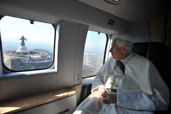 Pope Benedict XVI aboard an helicopter, looks at the Sanctuary of Cristo Rey near Parque del Bicentenario in Silao, Mexico, Sunday, March 25, 2012. Benedict arrived in Mexico Friday afternoon, a decade after the late Pope John Paul II&#39;s last visit, and will travel to Cuba on Monday <span class=meta>(AP Photo&#47;Osservatore Romano)</span>