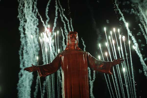 Fireworks explode as the new lights of the Christ King statue are inaugurated remotely by Pope Benedict XVI at the Cubilete Hill near Silao, Mexico, Sunday, March 25, 2012. Benedict arrived in Mexico Friday afternoon, a decade after the late Pope John Paul II&#39;s last visit, and will travel to Cuba on Monday <span class=meta>(AP Photo&#47;Dario Lopez-Mills)</span>