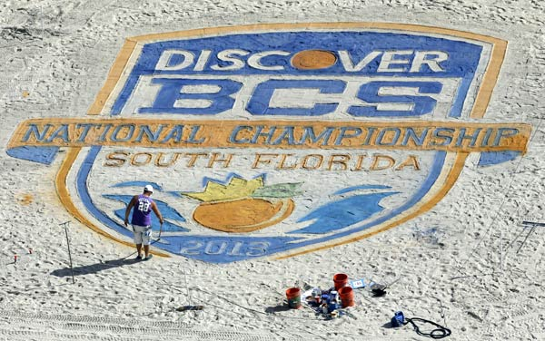 "<div class=""meta ""><span class=""caption-text "">An artist puts the finishing touches on the BCS National Championship logo on the beach Sunday, Jan. 6, 2013, in Fort Lauderdale, Fla. Notre Dame takes on Alabama for the National Championship in an NCAA college football game on Monday night. (AP Photo/Chris O'Meara)</span></div>"