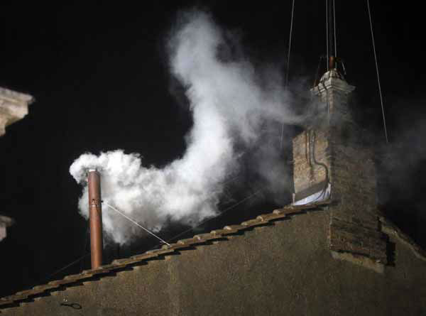 "<div class=""meta image-caption""><div class=""origin-logo origin-image ""><span></span></div><span class=""caption-text"">White smoke emerges from the chimney on the roof of the Sistine Chapel, in St. Peter's Square at the Vatican, Wednesday, March 13, 2013. The white smoke indicates that the new pope has been elected. (AP Photo/Gregorio Borgia) (AP Photo/ Gregorio Borgia)</span></div>"