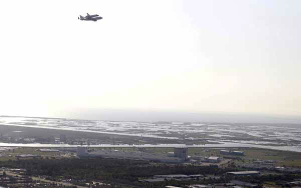 Space Shuttle Endeavour is seen in this aerial photo flying over NASA&#39;s Michoud Assembly Facility, where the external fuel tanks for the shuttle program were made, in New Orleans, Wednesday, Sept. 19, 2012.  Endeavour  will make a stop in Houston before heading to the California Science Center in Los Angeles. &#40;AP Photo&#47;Gerald Herbert&#41; <span class=meta>(AP Photo&#47; Gerald Herbert)</span>