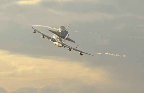 Space shuttle Endeavour makes its departure atop a modified jumbo jet from the Kennedy Space Center, Wednesday, Sept. 19, 2012, in Cape Canaveral, Fla. Endeavour will make a stop in Houston before heading to the California Science Center in Los Angeles. &#40;AP Photo&#47;John Raoux&#41; <span class=meta>(AP Photo&#47; John Raoux)</span>