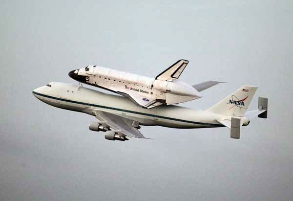 Space shuttle Endeavour atop a modified jumbo jet makes its departure from the Kennedy Space Center,  Wednesday, Sept. 19, 2012, in Cape Canaveral, Fla. Endeavour will make a stop in Houston before heading to the California Science Center in Los Angeles.&#40;AP Photo&#47;John Raoux&#41; <span class=meta>(AP Photo&#47; John Raoux)</span>
