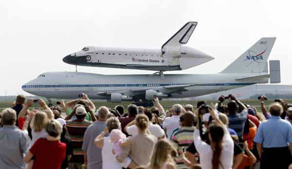 Space shuttle Endeavour sits atop NASA&#39;s Shuttle Carrier Aircraft, or SCA, Wednesday, Sept. 19, 2012, at Ellington Field in Houston. Endeavour is making a final trek across the country to the California Science Center in Los Angeles, where it will be permanently displayed. &#40;AP Photo&#47;David J. Phillip&#41; <span class=meta>(AP Photo&#47; David J. Phillip)</span>