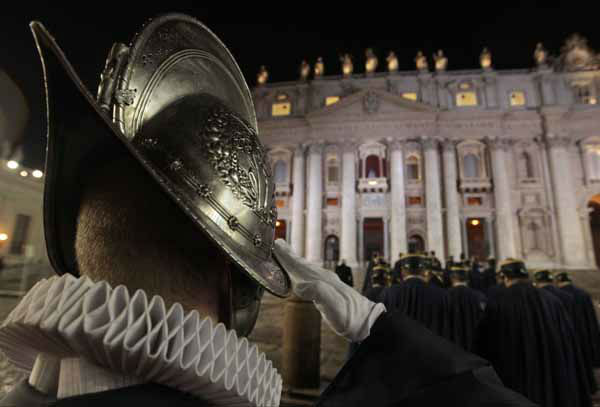 A Swiss guard salutes, in St. Peter&#39;s Square at the Vatican, Wednesday, March 13, 2013. The Catholic church has chosen a new pope. White smoke is billowing from the chimney of the Sistine Chapel, meaning 115 cardinals in a papal conclave have elected a new leader for the world&#39;s 1.2 billion Catholics. &#40;AP Photo&#47;Gregorio Borgia&#41; <span class=meta>(AP Photo&#47; Gregorio Borgia)</span>