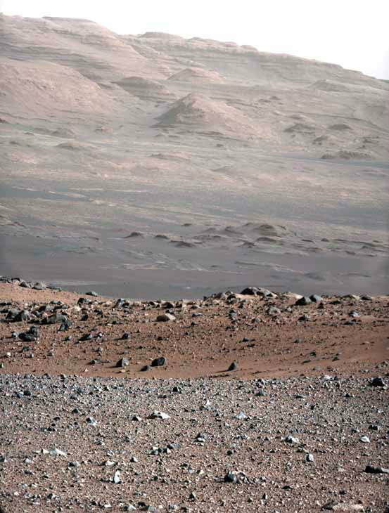 In this image released by NASA on Monday, Aug. 27, 2012, An image from a test series used to characterize the 100-millimeter Mast Camera on NASA&#39;s Curiosity rover taken on Aug. 23, 2012, looking south-southwest from the rover&#39;s landing site. The 100-millimeter Mastcam has three times better resolution than Curiosity&#39;s 34-millimeter Mastcam, though it has a narrower field of view. The gravelly area around Curiosity&#39;s landing site is visible in the foreground. Farther away, about a third of the way up from the bottom of the image, the terrain falls off into a depression &#40;a swale&#41;. Beyond the swale, in the middle of the image, is the boulder-strewn, red-brown rim of a moderately-sized impact crater. Farther off in the distance, there are dark dunes and then the layered rock at the base of Mount Sharp. Some haze obscures the view, but the top ridge, depicted in this image, is 10 miles &#40;16.2 kilometers&#41; away. Scientists enhanced the color in one version to show the Martian scene under the lighting conditions we have on Earth, which helps in analyzing the terrain. &#40;AP Photo&#47;NASA&#47;JPL-Caltech&#47;MSSS&#41; <span class=meta>(AP Photo&#47; DD JN**NY**)</span>