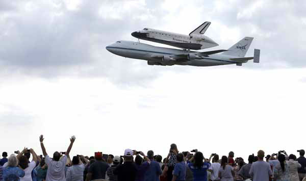 Space shuttle Endeavour flies over Ellington Field in Houston atop the shuttle aircraft carrier Wednesday, Sept. 19, 2012. Endeavour is making a final trek across the country to the California Science Center in Los Angeles, where it will be permanently displayed. &#40;AP Photo&#47;David J. Phillip&#41; <span class=meta>(AP Photo&#47; David J. Phillip)</span>