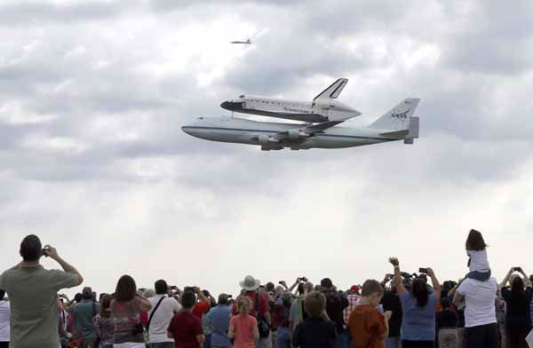 Space shuttle Endeavour flies over Ellington Field atop the shuttle aircraft carrier Wednesday, Sept. 19, 2012, in Houston. Endeavour is making a final trek across the country to the California Science Center in Los Angeles, where it will be permanently displayed. &#40;AP Photo&#47;David J. Phillip&#41; <span class=meta>(AP Photo&#47; David J. Phillip)</span>
