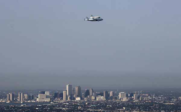 Space Shuttle Endeavour is seen in this aerial photo flying over the skyline of New Orleans, Wednesday, Sept. 19, 2012. Endeavour  will make a stop in Houston before heading to the California Science Center in Los Angeles. &#40;AP Photo&#47;Gerald Herbert&#41; <span class=meta>(AP Photo&#47; Gerald Herbert)</span>