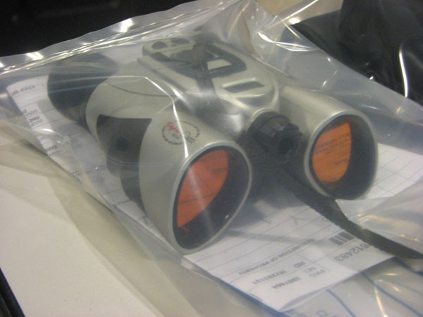 "<div class=""meta image-caption""><div class=""origin-logo origin-image ""><span></span></div><span class=""caption-text"">A pair of binoculars in an evidence bag waiting to be identified by its owner, as seen on Friday, June 01, 2012. (ABC7Chicago.com / Evan Peterson)</span></div>"