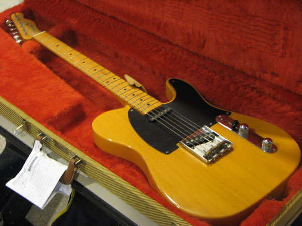 "<div class=""meta image-caption""><div class=""origin-logo origin-image ""><span></span></div><span class=""caption-text"">A Fender Telecaster guitar was one of the more expensive musical instruments recovered from the West Side search warrant. Police are asking people wanting to claim ownership of the guitar, as well as all lost property, to bring proof of ownership in with them to the Austin District Station. Photo taken on Friday, June 01, 2012. (ABC7Chicago.com / Evan Peterson)</span></div>"