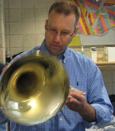 "<div class=""meta image-caption""><div class=""origin-logo origin-image ""><span></span></div><span class=""caption-text"">Greg Johnson looks for an identification number on a French horn on Friday, June 01, 2012. (ABC7Chicago.com / Evan Peterson)</span></div>"