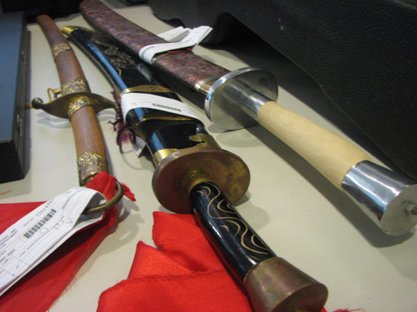 "<div class=""meta image-caption""><div class=""origin-logo origin-image ""><span></span></div><span class=""caption-text"">These three swords are also some of the more bizarre items that were stolen from people that the CPD recovered, Friday, June 01, 2012. (ABC7Chicago.com / Evan Peterson)</span></div>"