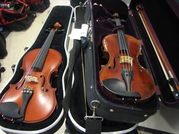 "<div class=""meta image-caption""><div class=""origin-logo origin-image ""><span></span></div><span class=""caption-text"">This violin (right) and viola (left) were two of the instruments recovered by the CPD after a search warrant on the city's West Side. Police estimate the viola is worth more than $1,000. Anyone claiming one of these stolen instruments must present proof of ownership; you must do this to recover any of the stolen property at the Austin District Police Station, Friday, June 01, 2012. (ABC7Chicago.com / Evan Peterson)</span></div>"