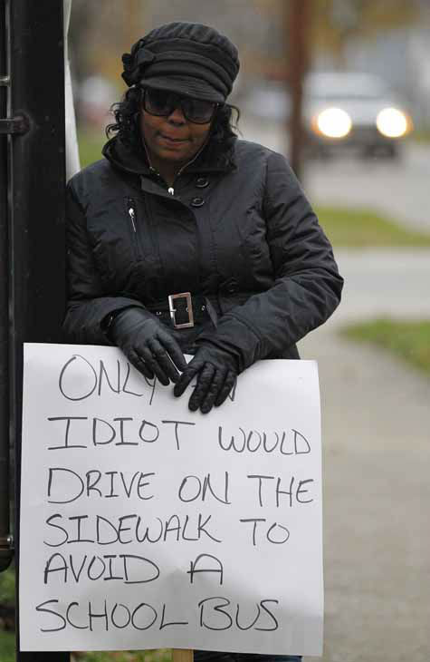 "<div class=""meta ""><span class=""caption-text "">Shena Hardin holds up a sign to serve a highly public sentence Tuesday, Nov. 13, 2012, in Cleveland, for driving on a sidewalk to avoid a Cleveland school bus that was unloading children. A Cleveland Municipal Court judge ordered 32-year-old Hardin to serve the highly public sentence for one hour Tuesday and Wednesday. (AP Photo/Tony Dejak) (AP Photo/ Tony Dejak)</span></div>"