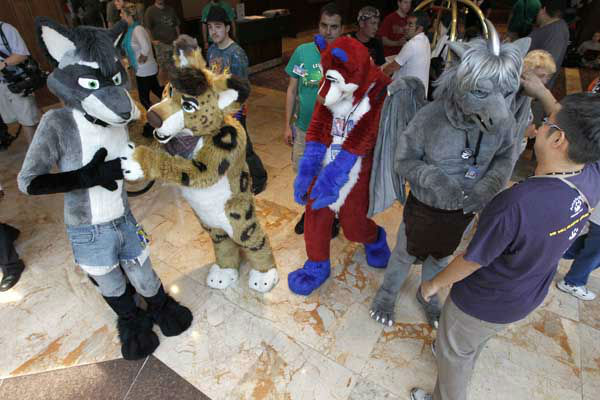 "<div class=""meta ""><span class=""caption-text "">In this photo made on Thursday, June 14, 2012, people attending Anthrocon, some in animal costumes,  greet and mingle in the lobby of the Westin Convention Center hotel in Pittsburgh. Anthrocon, the world's largest convention for people who dress and assume the rolls of fictional animal characters, is back in its adopted home with an expected 5,000 participants between June 14 thru 17, 2012. (AP Photo/Keith Srakocic) (AP Photo/ Keith Srakocic)</span></div>"
