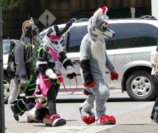 In this photo made on Thursday, June 14, 2012, people in animal costumes walk down Penn Ave. near the David Lawrence Convention Center in Pittsburgh. Anthrocon, the world&#39;s largest convention for people who dress and assume the rolls of fictional animal characters, is back in its adopted home with an expected 5,000 participants between June 14 to 17, 2012. &#40;AP Photo&#47;Keith Srakocic&#41; <span class=meta>(AP Photo&#47; Keith Srakocic)</span>