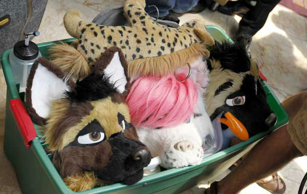 In this photo made on Thursday, June 14, 2012, visitors attending Anthrocon move a container with costume parts through the lobby of the Westin Convention Center hotel in Pittsburgh. Anthrocon, the world&#39;s largest convention for people who dress and assume the rolls of fictional animal characters, is back in its adopted home with an expected 5,000 participants between June 14 to 17, 2012. &#40;AP Photo&#47;Keith Srakocic&#41; <span class=meta>(AP Photo&#47; Keith Srakocic)</span>