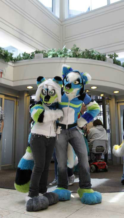 "<div class=""meta image-caption""><div class=""origin-logo origin-image ""><span></span></div><span class=""caption-text"">In this photo made on Thursday, June 14, 2012, two characters from Quebec City, Canada, one costumed as a colorful raccoon she calls ""Vellocet"" at left, and her friend ""Sneety"" a husky, pose for a photo in the entrance of the lobby of the Westin Convention Center hotel in Pittsburgh. Anthrocon, the world's largest convention for people who dress and assume the rolls of fictional animal characters, is back in its adopted home with an expected 5,000 participants between June 14 to 17, 2012. (AP Photo/Keith Srakocic) (AP Photo/ Keith Srakocic)</span></div>"