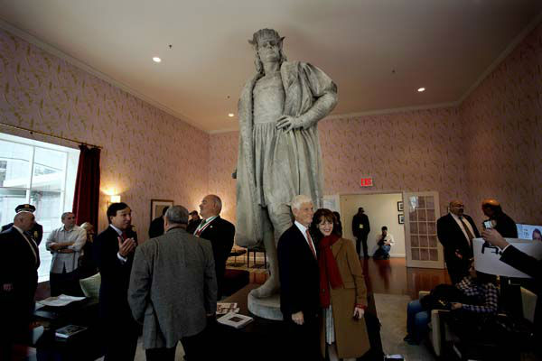 Leaders of the Italian-American community, civil servants from New York and Italy, including police and sanitation workers and other guests, stand in what is known as the living room created by artist Tatzu Nishi that surrounds Gaetano Russo&#39;s 1892 sculpture of Christopher Columbus 75 Feet Above Columbus Circle Sunday, Oct. 7, 2012, in New York. The art  installation ?Tatzu Nishi: Discovering Columbus,&#34; which brings people to eye level with the Columbus statue, became part of an annual wreath laying ceremony that celebrates Columbus Day. Posing center right for a photograph is Mario Gabelli, Grand Marshall of the 2012 Columbus Day parade, and his wife Regina Pitano. &#40;AP Photo&#47;Craig Ruttle&#41; <span class=meta>(AP Photo&#47; Craig Ruttle)</span>