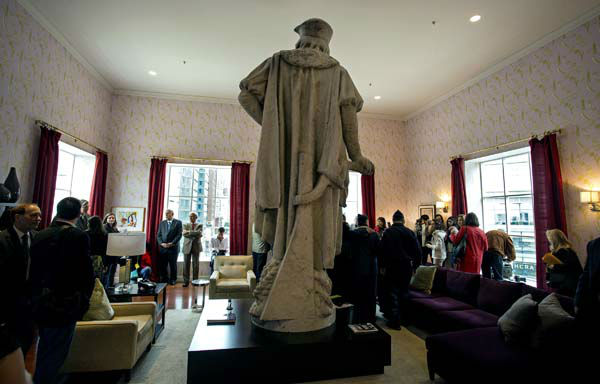Leaders of the Italian-American community, civil servants from New York, and Italy, including police and sanitation workers and other guests, stand in what is known as the living room created by artist Tatzu Nishi that surrounds Gaetano Russo&#39;s 1892 sculpture of Christopher Columbus 75 Feet Above Columbus Circle Sunday, Oct. 7, 2012, in New York. The art  installation ?Tatzu Nishi: Discovering Columbus,&#34; which brings people to eye level with the Columbus statue, became part of an annual wreath laying ceremony that celebrates Columbus Day. &#40;AP Photo&#47;Craig Ruttle&#41; <span class=meta>(AP Photo&#47; Craig Ruttle)</span>