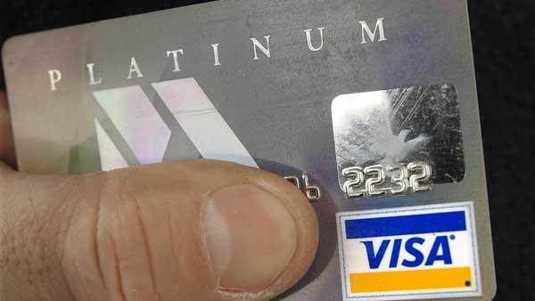 FILE--The Visa logo on a card holders credit card is shown in Springfield, Ill., Monday, Feb. 25, 2008. (AP Photo/Seth Perlman)