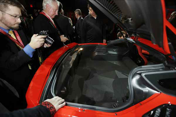 The rear trunk hood is opened to highlight the trunk space of the new Corvette Stingray after its unveiling in Detroit, Sunday, Jan. 13, 2013, the night before press days at the North American International Auto Show in Detroit. When 1,000 GM engineers and designers started work on the next-generation Corvette, they began with the usual priority list for a muscle car, but topping the list was something that belies the roar of the Chevrolet&#39;s giant V-8: Gas mileage. &#40;AP Photo&#47;Carlos Osorio&#41; <span class=meta>(AP Photo&#47; Carlos Osorio)</span>