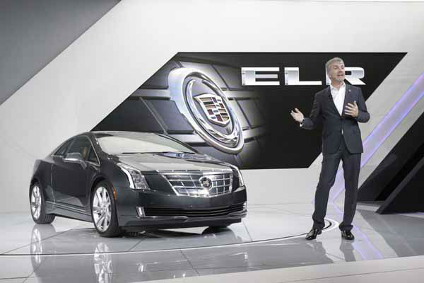 Mark Adams, Executive Director of Cadillac Global Design stands next to the Cadillac ELR after its unveiling during the North American International Auto Show in Detroit, Tuesday, Jan. 15, 2013. &#40;AP Photo&#47;Carlos Osorio&#41; <span class=meta>(AP Photo&#47; Carlos Osorio)</span>