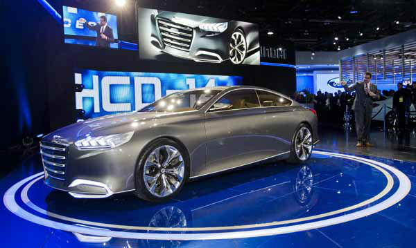 Hyundai Chief Designer Chris Chapman, right, shows off the Genesis HCD-14 concept car, at the North American International Auto Show, Monday, Jan. 14, 2013, in Detroit, Mich. &#40;AP Photo&#47;Tony Ding&#41; <span class=meta>(AP Photo&#47; TONY DING)</span>