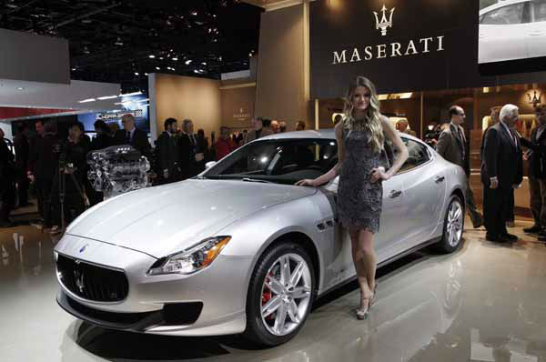 A model poses with the 2014 Maserati Quattroporte at media previews for the North American International Auto Show in Detroit, Monday, Jan. 14, 2013.  &#40;AP Photo&#47;Paul Sancya&#41; <span class=meta>(AP Photo&#47; Paul Sancya)</span>