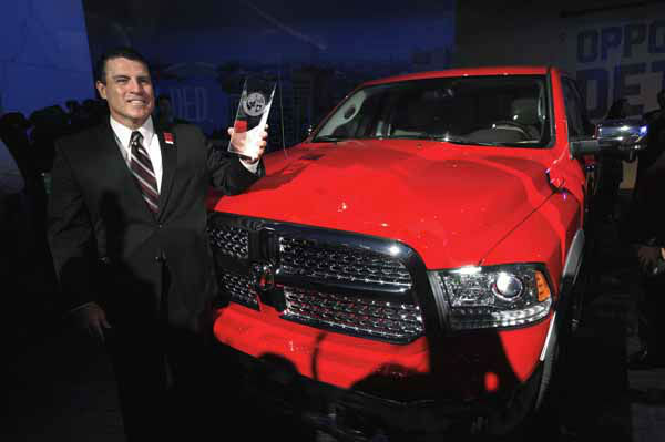 Fred Diaz, President and Chief Executive Officer, Ram Truck Brand, stands with the Ram 1500 after the vehicle was awarded the North American Truck of the Year at media previews for the North American International Auto Show in Detroit, Monday, Jan. 14, 2013.  &#40;AP Photo&#47;Paul Sancya&#41; <span class=meta>(AP Photo&#47; Paul Sancya)</span>