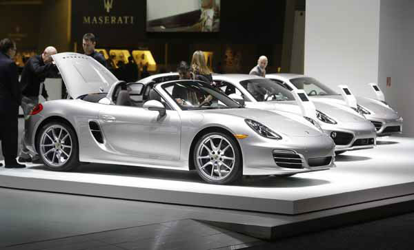 Journalists look over a Porsche Boxster during the North American International Auto Show in Detroit, Monday, Jan. 14, 2013. &#40;AP Photo&#47;Carlos Osorio&#41; <span class=meta>(AP Photo&#47; Carlos Osorio)</span>