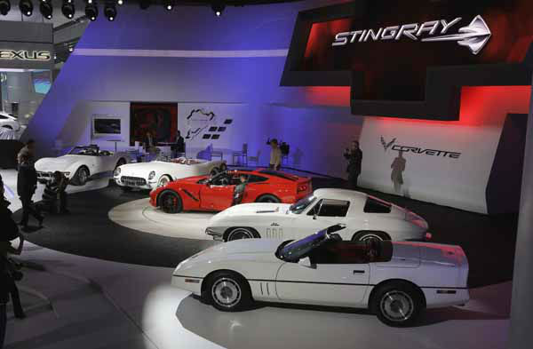 The Chevrolet Corvette Stingray,  in red, is seen with previous models during media previews for the North American International Auto Show in Detroit, Monday, Jan. 14, 2013. &#40;AP Photo&#47;Carlos Osorio&#41; <span class=meta>(AP Photo&#47; Carlos Osorio)</span>