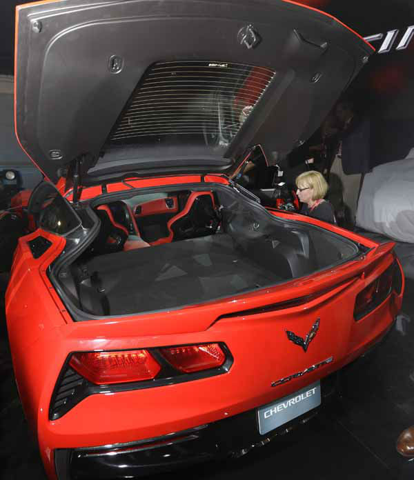 "<div class=""meta ""><span class=""caption-text "">The rear trunk hood is opened to highlight the trunk space of the new Corvette Stingray after its unveiling in Detroit, Sunday, Jan. 13, 2013, the night before press days at the North American International Auto Show in Detroit. When 1,000 GM engineers and designers started work on the next-generation Corvette, they began with the usual priority list for a muscle car, but topping the list was something that belies the roar of the Chevrolet's giant V-8: Gas mileage. (AP Photo/Carlos Osorio) (AP Photo/ Carlos Osorio)</span></div>"