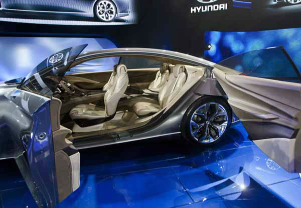 The newly unveiled Hyundai Genesis HCD-14 concept car, sporting &#34;suicide doors&#34;, at the North American International Auto Show, Monday, Jan. 14, 2013, in Detroit, Mich. &#40;AP Photo&#47;Tony Ding&#41; <span class=meta>(AP Photo&#47; TONY DING)</span>