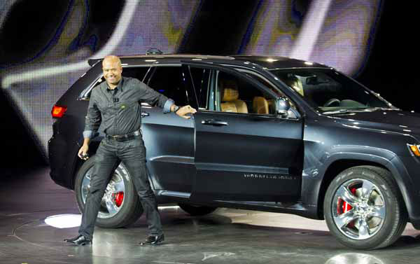 Chrysler SRT Brand President and CEO Ralph Gilles steps out of a 2014 Jeep Grand Cherokee SRT, at the North American International Auto Show, Monday, Jan. 14, 2013, in Detroit, Mich. &#40;AP Photo&#47;Tony Ding&#41; <span class=meta>(AP Photo&#47; TONY DING)</span>