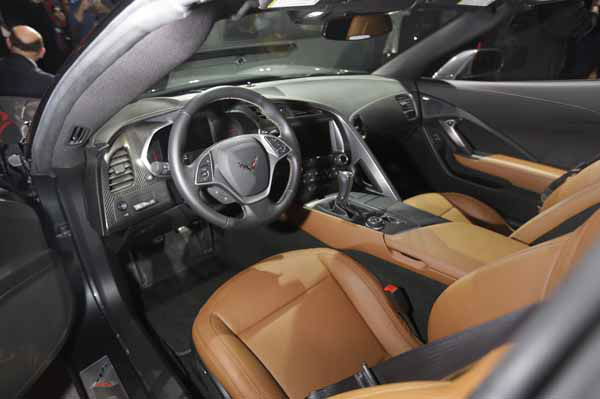 The interior of the new Corvette Stingray is displayed after its unveiling in Detroit, Sunday, Jan. 13, 2013, the night before press days at the North American International Auto Show in Detroit. When 1,000 GM engineers and designers started work on the next-generation Corvette, they began with the usual priority list for a muscle car, but topping the list was something that belies the roar of the Chevrolet&#39;s giant V-8: Gas mileage. &#40;AP Photo&#47;Carlos Osorio&#41; <span class=meta>(AP Photo&#47; Carlos Osorio)</span>